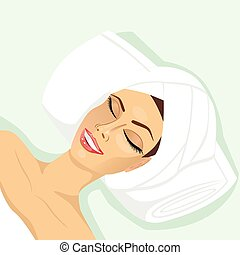 woman lying with closed eyes in spa