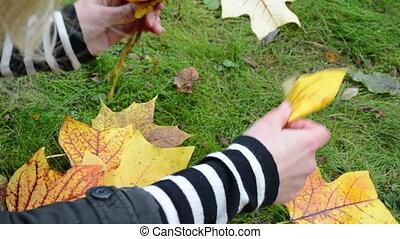 woman make flower leaf