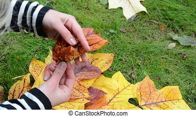 woman make flower leaves