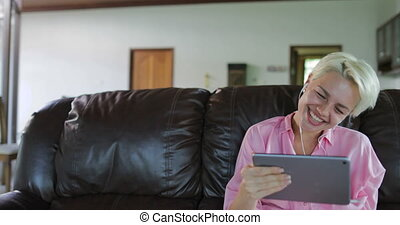 Woman Make Online Video Call Using Tablet Computer Sit On...