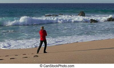 Woman Make Photo Waves in Ocean