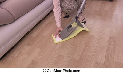 Woman make ready mop for floor cleaning