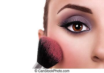 Beautiful woman make up and blush brush. Makeup.