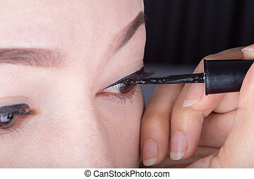 woman make-up with black eyeliner