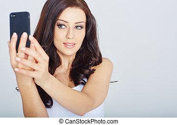woman makes a selfie in a studio