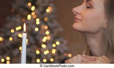 Woman Makes a Wish on Christmas.