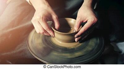 Woman Makes Clay Jug - Close up of woman potter's hands...