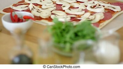 Woman making a delicious pepperoni pizza - Woman making a...