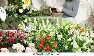 Woman making a flower arrangement in florist shop