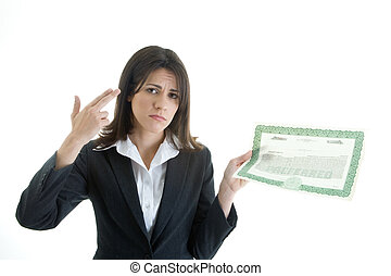 Woman making a gun gesture to her head while holding a stock certificate.