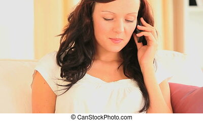 Woman making a phone call while hol