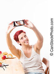 woman making a self portrait with her smartphone