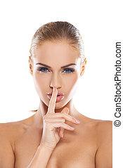 Woman making a shushing gesture - Beautiful woman with bare ...