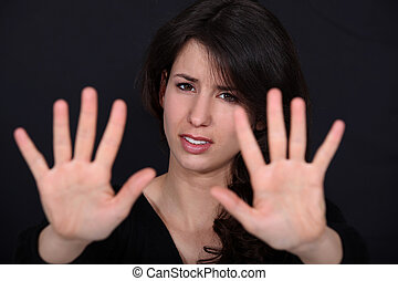 woman making a stop sign gesture with her hands