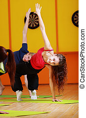 Woman making aerobics in group