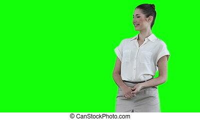 Woman making an announcement while using a virtual slideshow