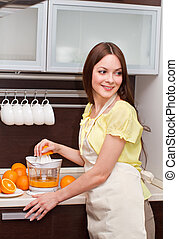 Woman making an orange juice