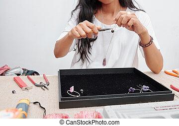 Woman making beautiful jewelry