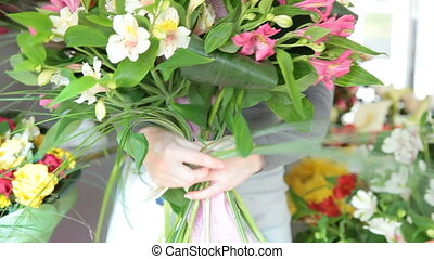 Woman making bunch of flowers