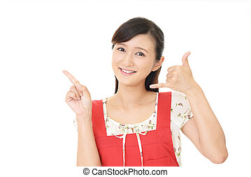 Woman making call me gesture phone hand sign