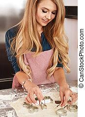 Woman making christmas cookies