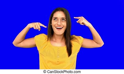 Woman making crazy gesture on blue