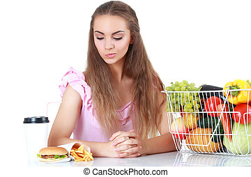 Woman making decision between healthy food and fast food