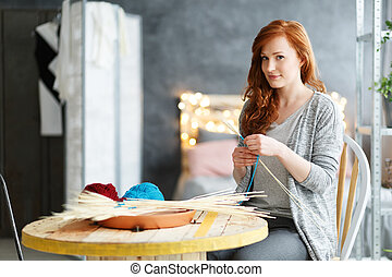 Woman making decorations at home