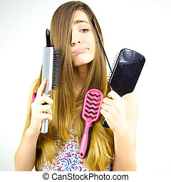 Woman making funny faces not knowing what to do with her hair and brushes