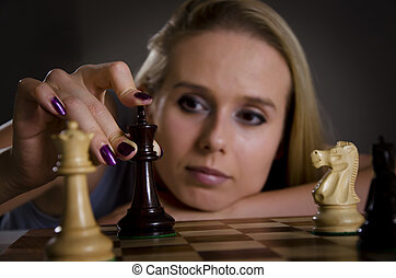 woman making her move in chess