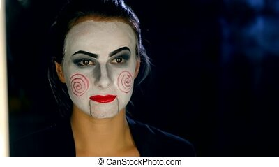Woman making horror style make-up - Young woman making...