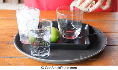 Woman making lemon soda drinks
