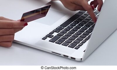 Woman making online shopping with laptop. Close up