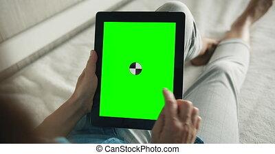 Woman Making Pick Gesture on Greenscreen Tablet - Female...