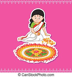 Woman making rangoli for Indian festival, Onam