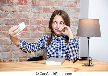 Woman making selfie photo