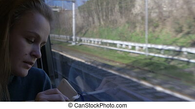 Woman making sketches during train ride - Young woman in...