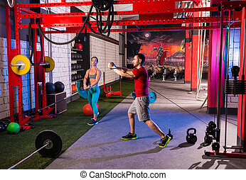 woman man gym group weightlifting workout