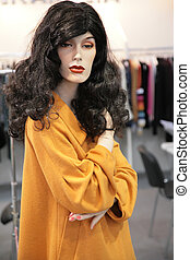 woman mannequin in yellow dress
