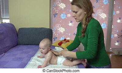woman massage baby