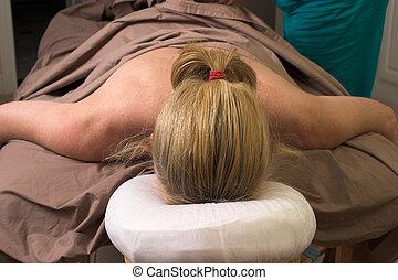 Woman Massage - Beautiful woman receiving relaxing massage...