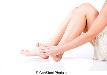 Woman massaging her aching foot, female problem