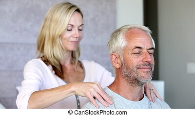Woman massaging her husband