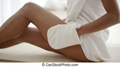 Woman Massaging Leg In Spa - Young woman massaging leg with...