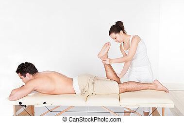 Woman Massaging Man's Foot