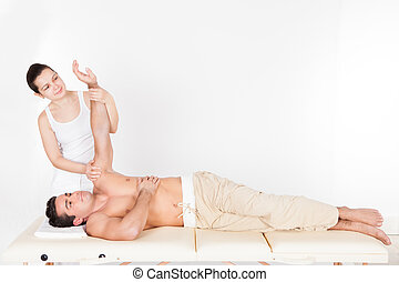 Woman Massaging Man's Hand