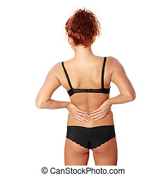 Woman massaging pain in her back