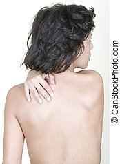 Woman massaging upper back pain, isolated on white...
