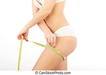 woman measure her body with tape