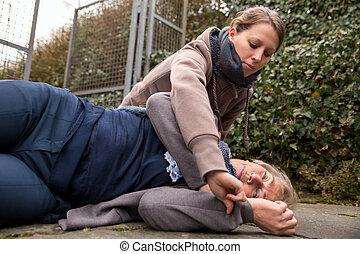 woman measures blood pressure